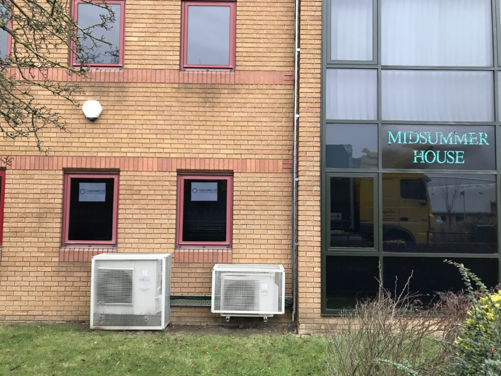Air Conditioning condenser units with security cages