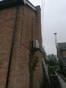 Bedroom AC system high level outdoor condenser